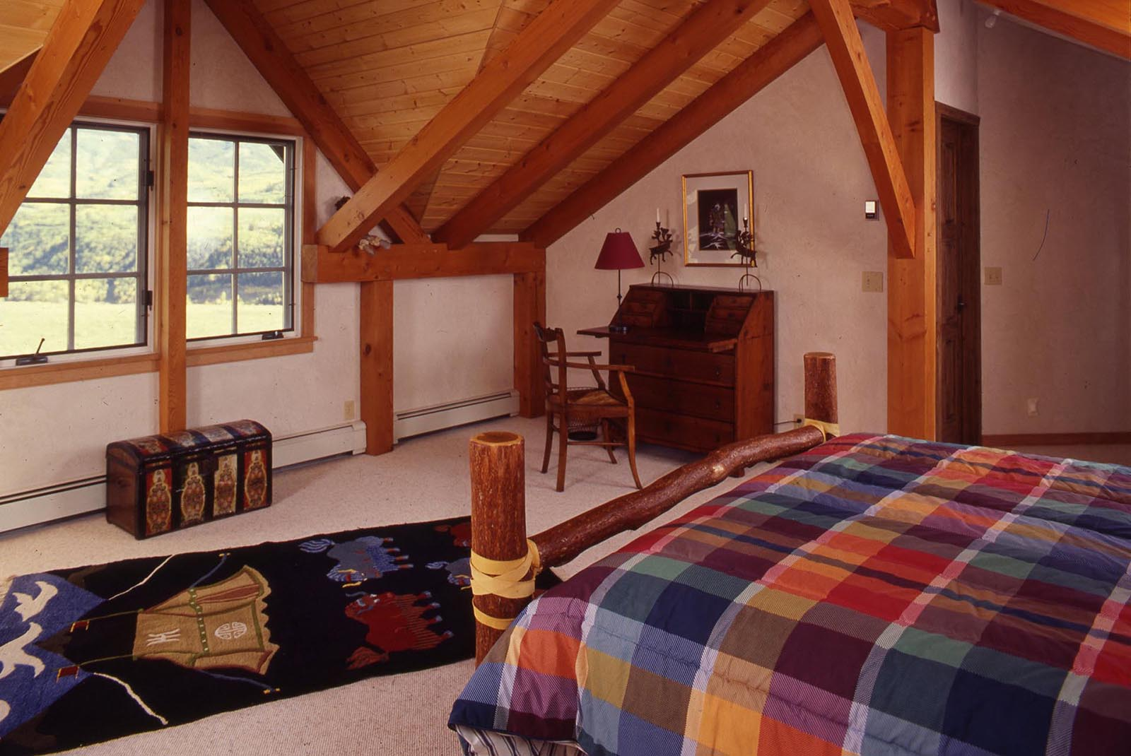 High Estate mountain living timberframe home second floor guest bedroom
